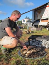 Jon grilling fish
