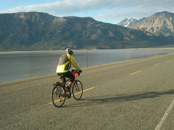 NAE 2013 - Stage 09 - Brian (TDA 11, TE 12) riding along Kluane Lake
