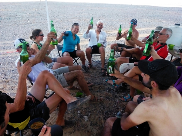 Riders enjoying a drink after 150km