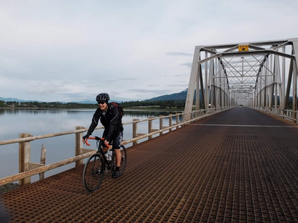 New sectional rider, Chris, crosses the Teslin river on an early morning.