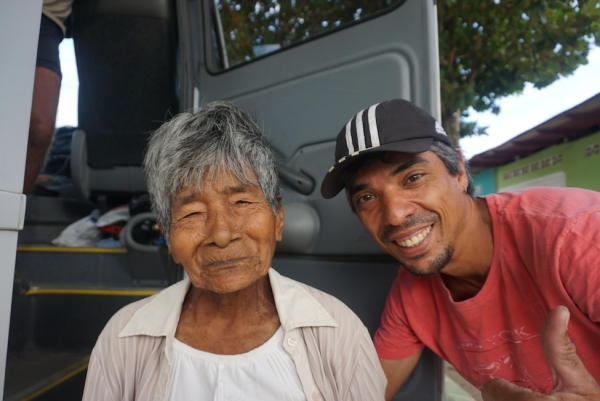 Luiz and a local woman named Veronica who hitched a ride to her village