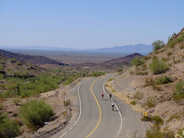 Riders embark on a long journey through the desert.
