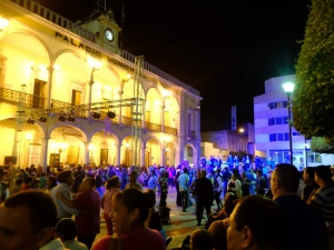A fiesta in the main plaza at night