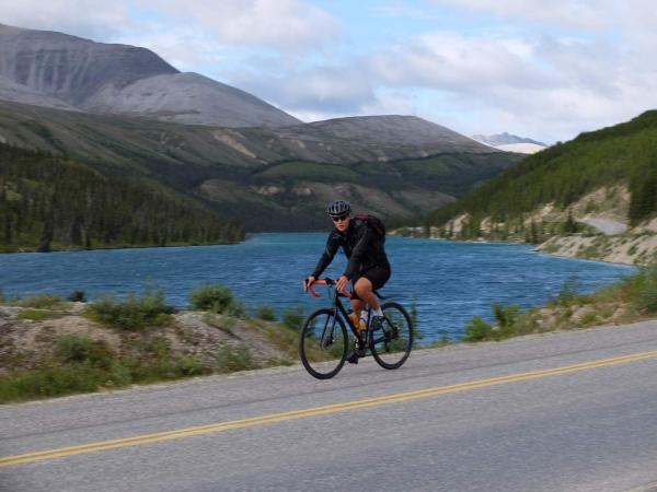 Chris pedals past Summit Lake.