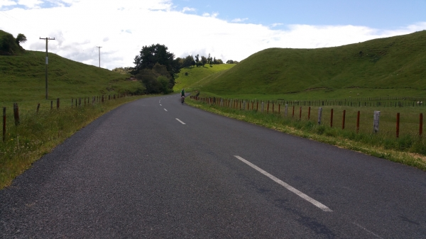Blog 12 - 05 - Rider cycling along rolling hills