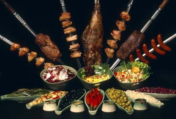 A churrascaria is a Brazilian steakhouse. Churrasco is the cooking style, which translates roughly from the Portuguese for 'barbecue'.