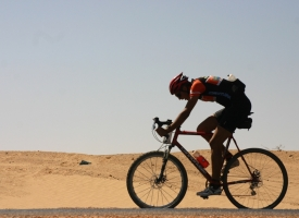 Sam sailing through the Sahara on blissful blacktop