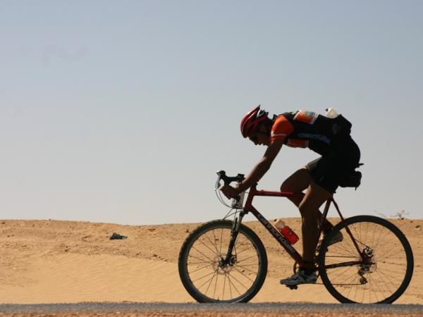 Sam sailing through the Sahara on blissful blacktop